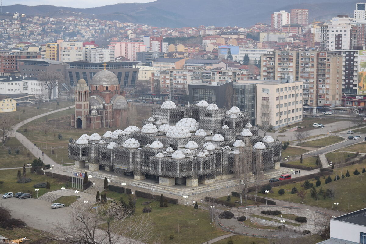 Pristina, the capital of Kosovo, with the National Library in the foreground. Photo by Liridon, via Wikimedia Commons.