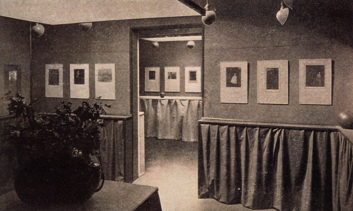 Photo of the Gertrude Käsebier and Clarence H. White exhibition at the Little Galleries of the Photo-Secession, February 1906. Image via Wikimedia Commons.