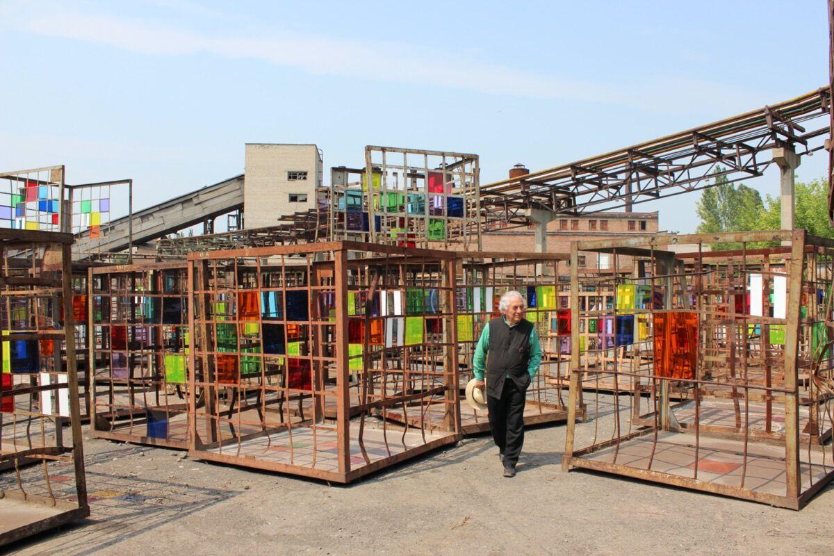 "Daniel Buren, installation view of Dans les filets, la couleur, 2012, in ""Where is the Time?,"" 2012. Photo by Dima Sergeev. Courtesy of IZOLYATSIA."