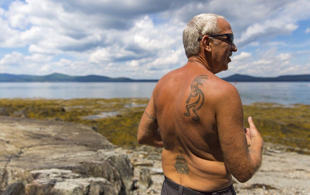 Kokopelli-tattooed Joe Dienes at Warren Island State Park, Ilesboro, Maine, 2016. Photo by Ben McCanna/Portland Press Herald via Getty Images.