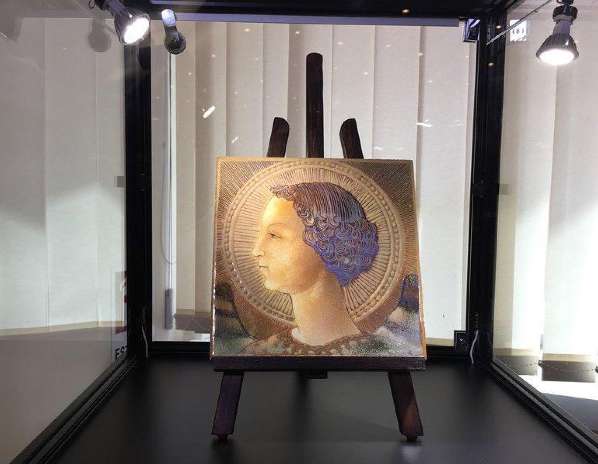 The purported Leonardo da Vinci tile on view in Rome. Courtesy of Press Office Handout/EPA.