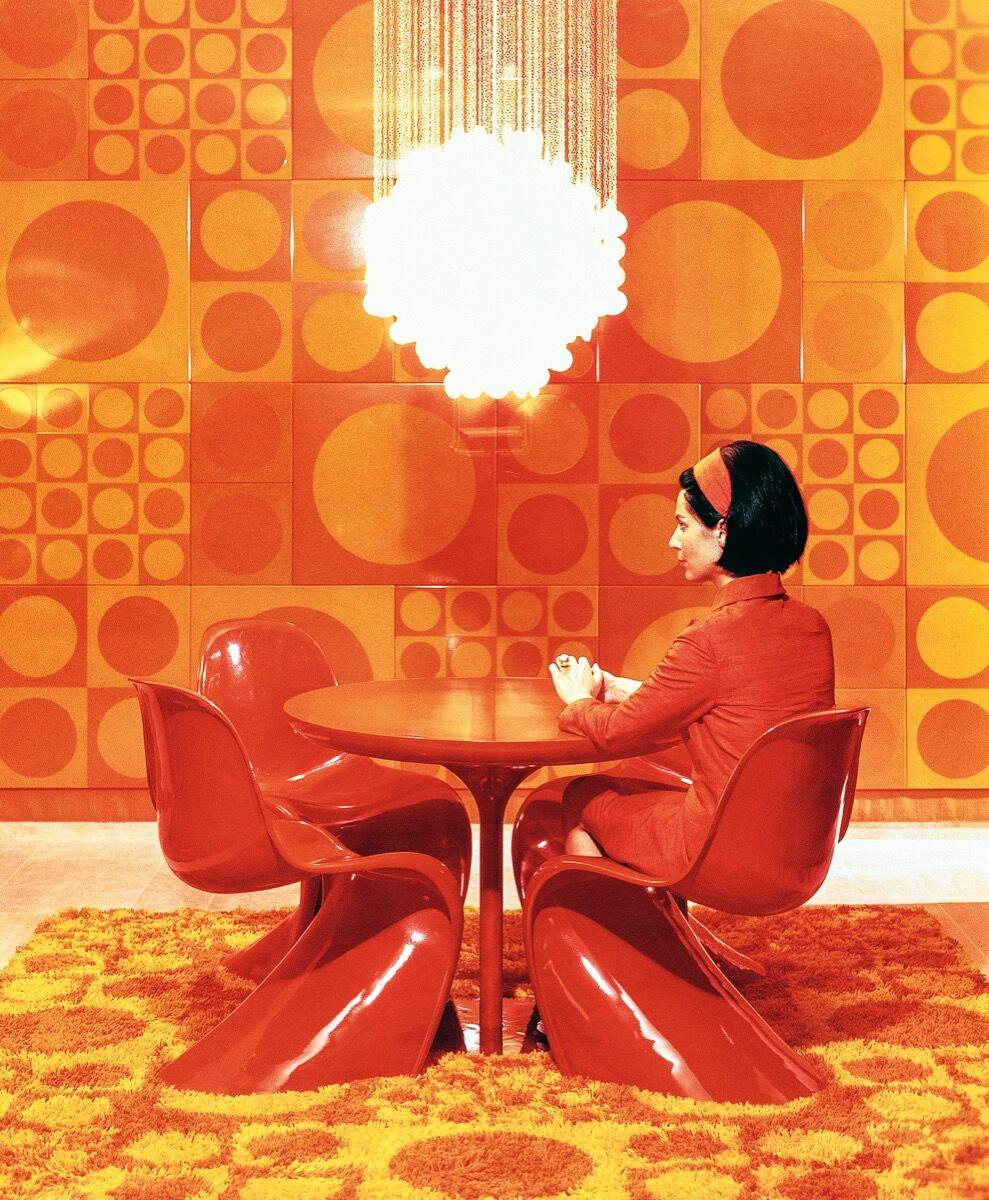 Marianne Panton on The Panton chair, with The Shell Lamp, and a Unika Vaev rug, 1967. © Panton Design, Basel.