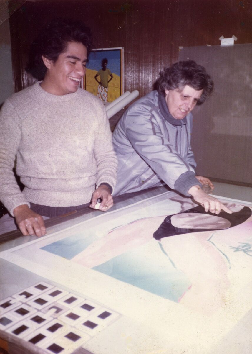 Sister Karen reviewing a serigraph with an artist in the Professional Printmaking Program. Courtesy of Self Help Graphics & Art.