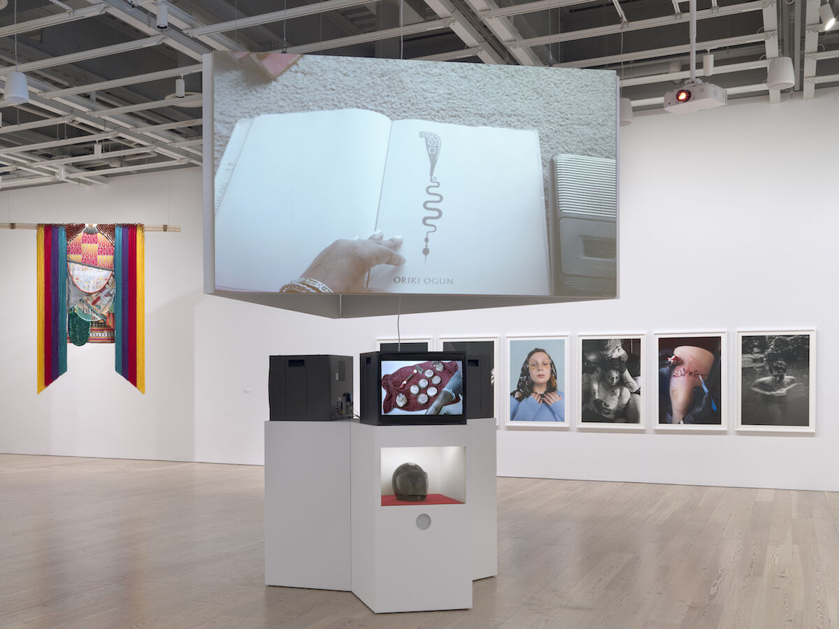 Installation view of the Whitney Biennial 2019 including, at center, Tiona Nekkia McClodden, I prayed to the wrong god for you, 2019. Photo by Ron Amstutz.