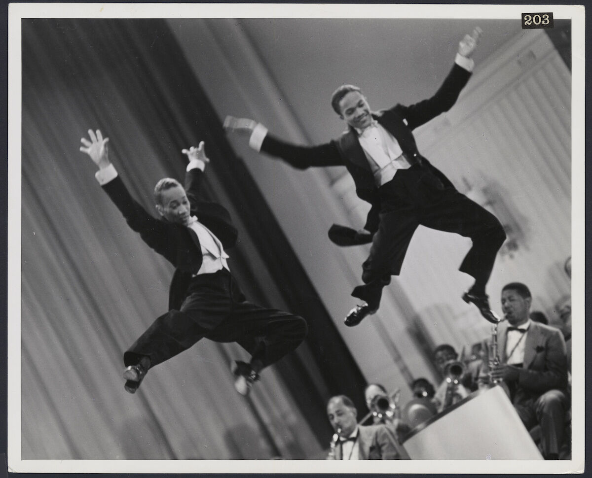 The Nicholas Brothers in a scene from Stormy Weather, 1943, Fayard Nicholas, left, and Harold Nicholas, photographic print, gelatin silver. Courtesy Margaret Herrick Library, © Twentieth Century Fox.