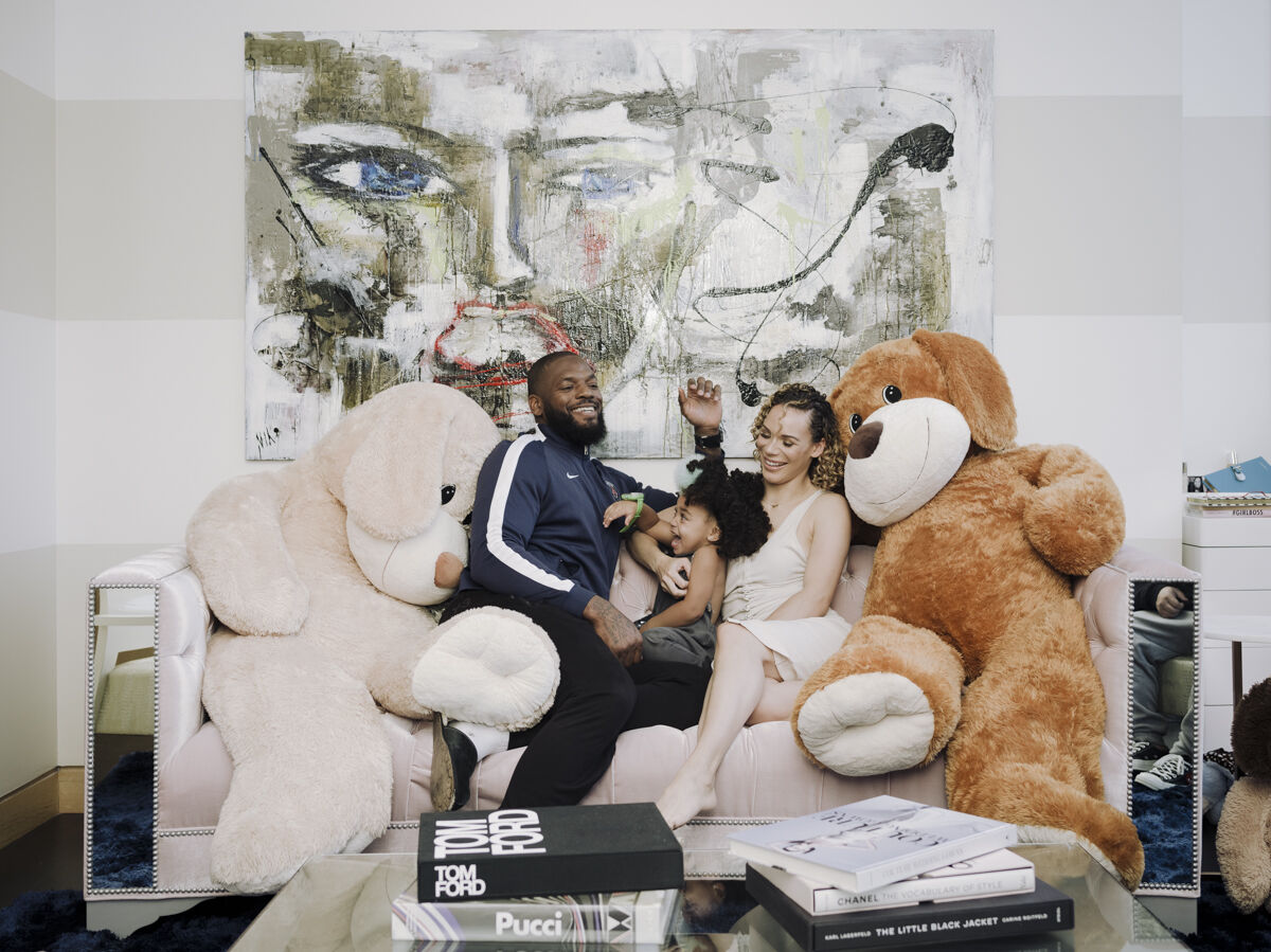 Portrait of Martellus Bennett, his daughter Jett, and his wife Siggi in their Chicago home by Whitten Sabbatini for Artsy.