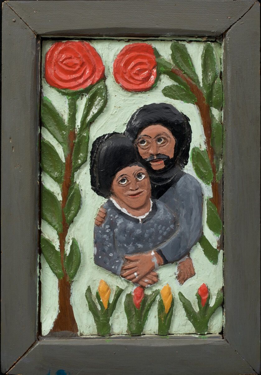 Elijah Pierce, Couple with Roses, 1975. Paint on carved wood. The Collection of Jill and Sheldon Bonovitz. Promised gift to the Philadelphia Museum of Art. Courtesy of the Barnes Foundation.