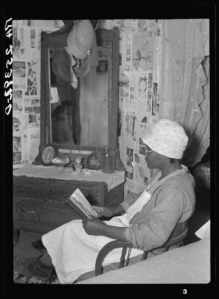 Quilter Jorena Pettway reading in her room, 1937. Photo by Arthur Rothstein. Courtesy of the Library of Congress.