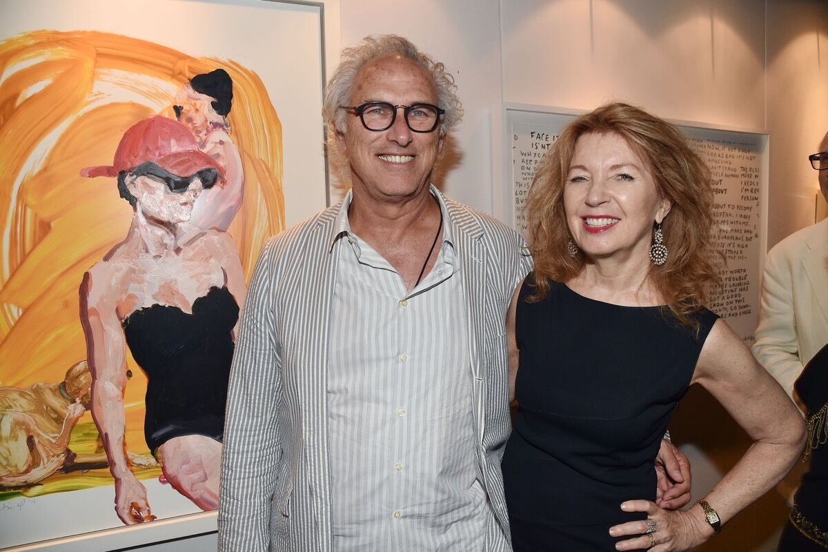 """Eric Fischl and April Gornik attend the Guild Hall 2017 Summer Gala Celebrating """"Avedon's America"""" at Guild Hall on August 11, 2017 in East Hampton, New York. Photo by Patrick McMullan/Patrick McMullan via Getty Images."""