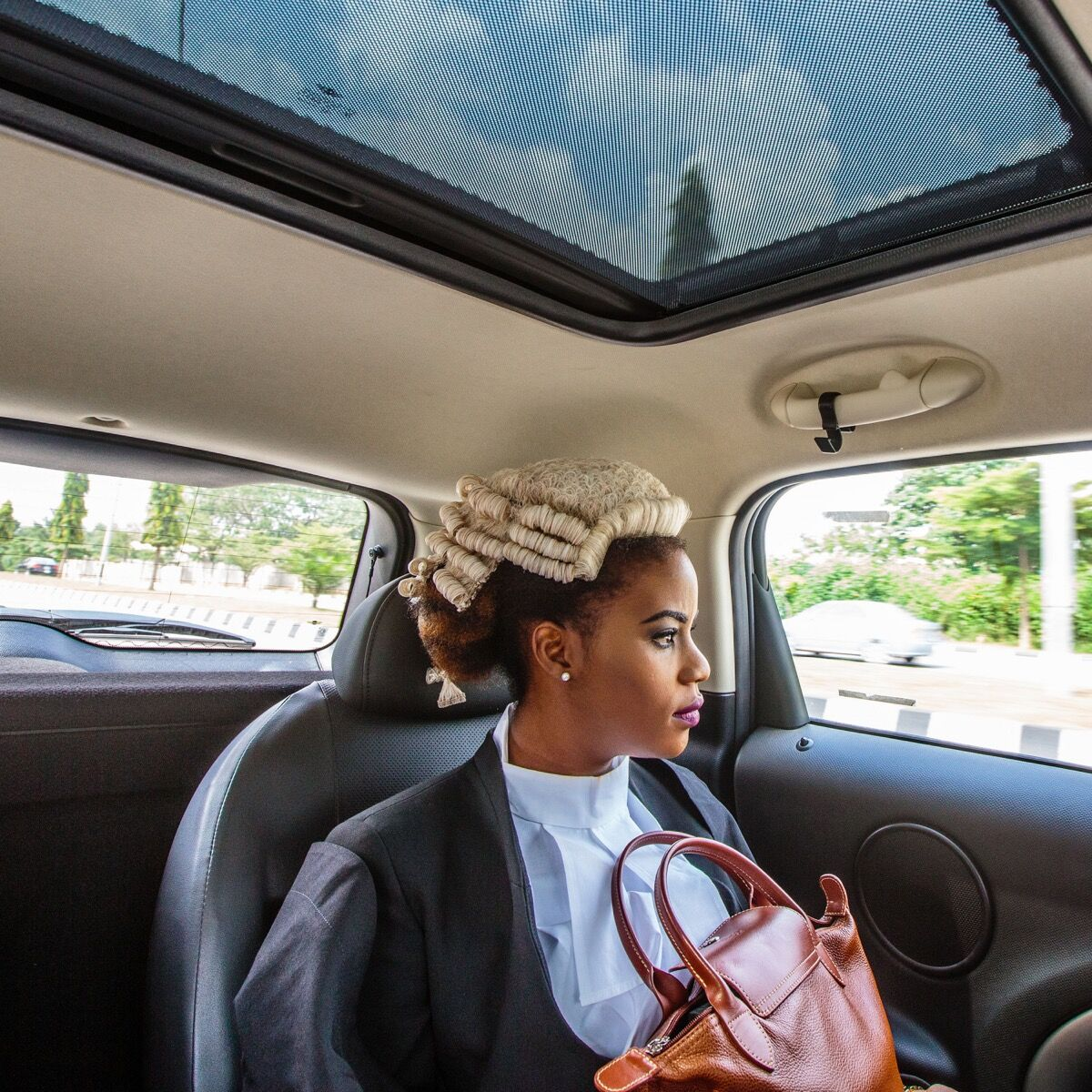 Ginika is on her way to join thousands of Nigerian law graduates being called to the bar in Abuja, Nigeria. Photo by @tomsaater.