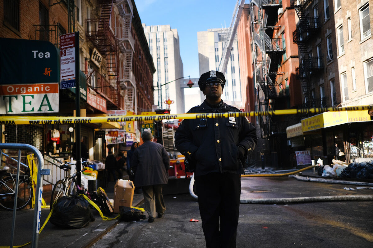 A police officer stands near the scene of a fire in Chinatown on January 24, 2020 in New York City. Photo by Spencer Platt/Getty Images.