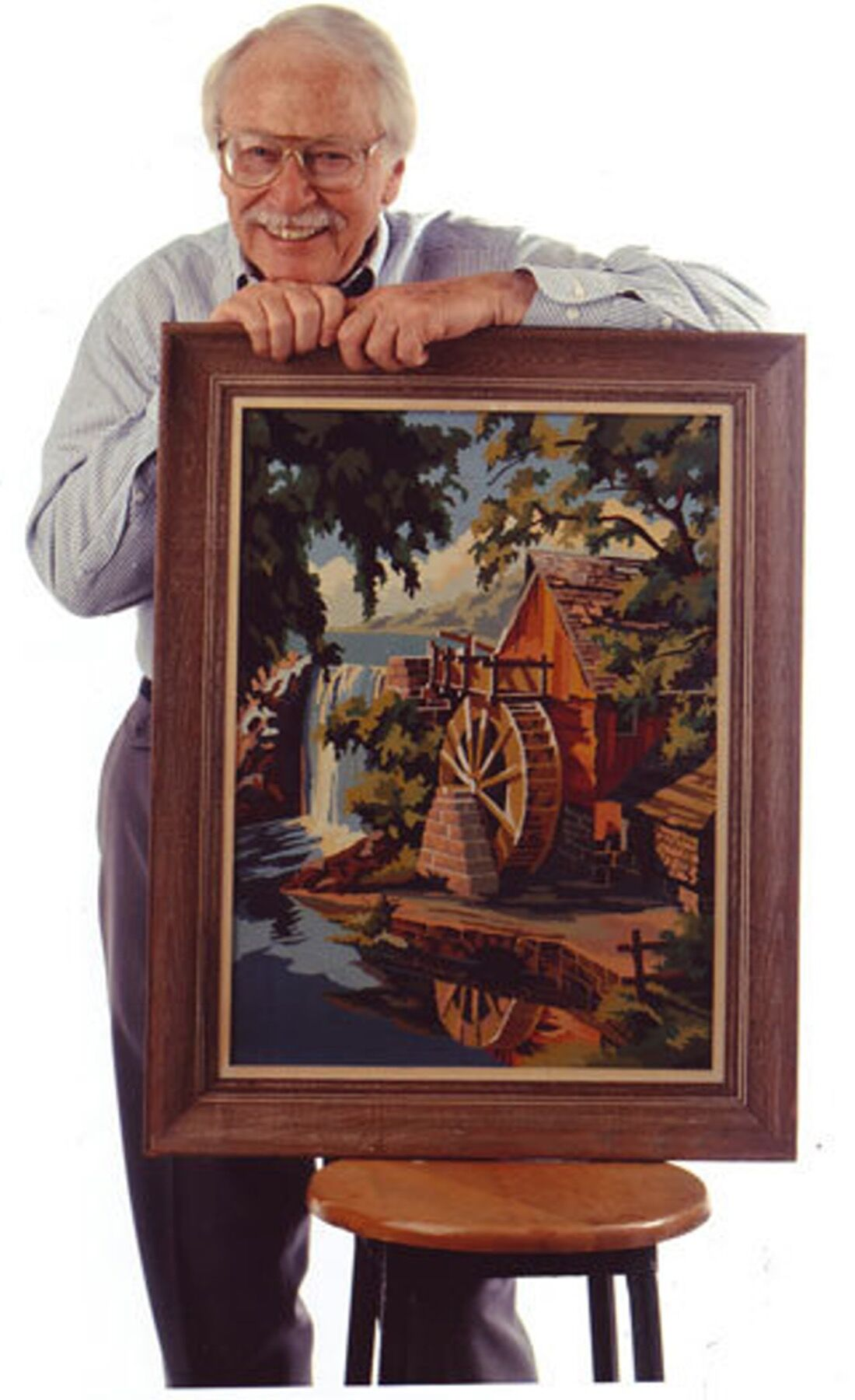 Dan Robbins holding his favorite Paint-By Number, Old Mill Stream, 1997. Courtesy of 20 North Gallery.