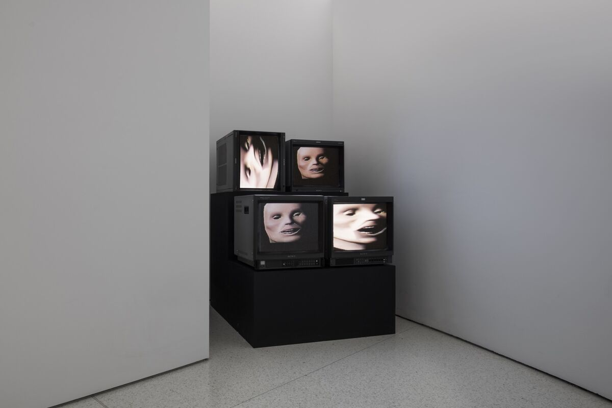 """Installation view of Gretchen Bender, Wild Dead I, II, III (Danceteria Version), 1984, in """"Gretchen Bender: So Much Deathless,"""" Red Bull Arts New York, 2019. Photo by Lance Brewer. © The Gretchen Bender Estate. Courtesy of Red Bull Arts and and OSMOS."""