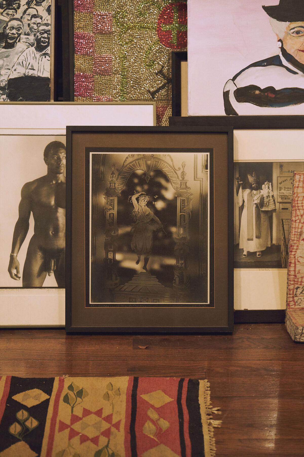 A patchwork of artists from New Orleans holds court along the dining room wall: On the left is a portrait of a nude athlete by George Dureau; at center is a photograph by Clarence John Laughlin, one of the early Surrealist photographers in America; and on the right is a work by documentary photographer Michael P. Smith. Photo by Michael Adno for Artsy.