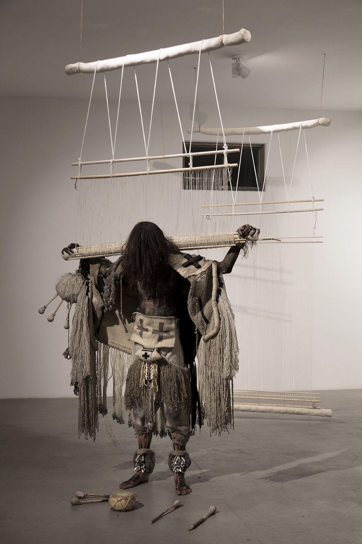 Eric-Paul Riege, dah 'iistl'o ́ [loomz], weaving dance (fig.1), 2018. Photo by Rapheal Begay. Courtesy of artist.