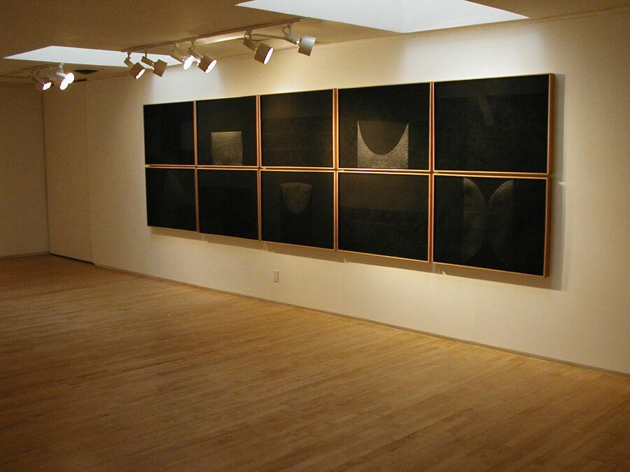 "Installation view of Alberto Burri's suite ""Mixoblack"" (1990). Mixografia prints on handmade paper. 55 x 196.25 inches. Edition of 30."