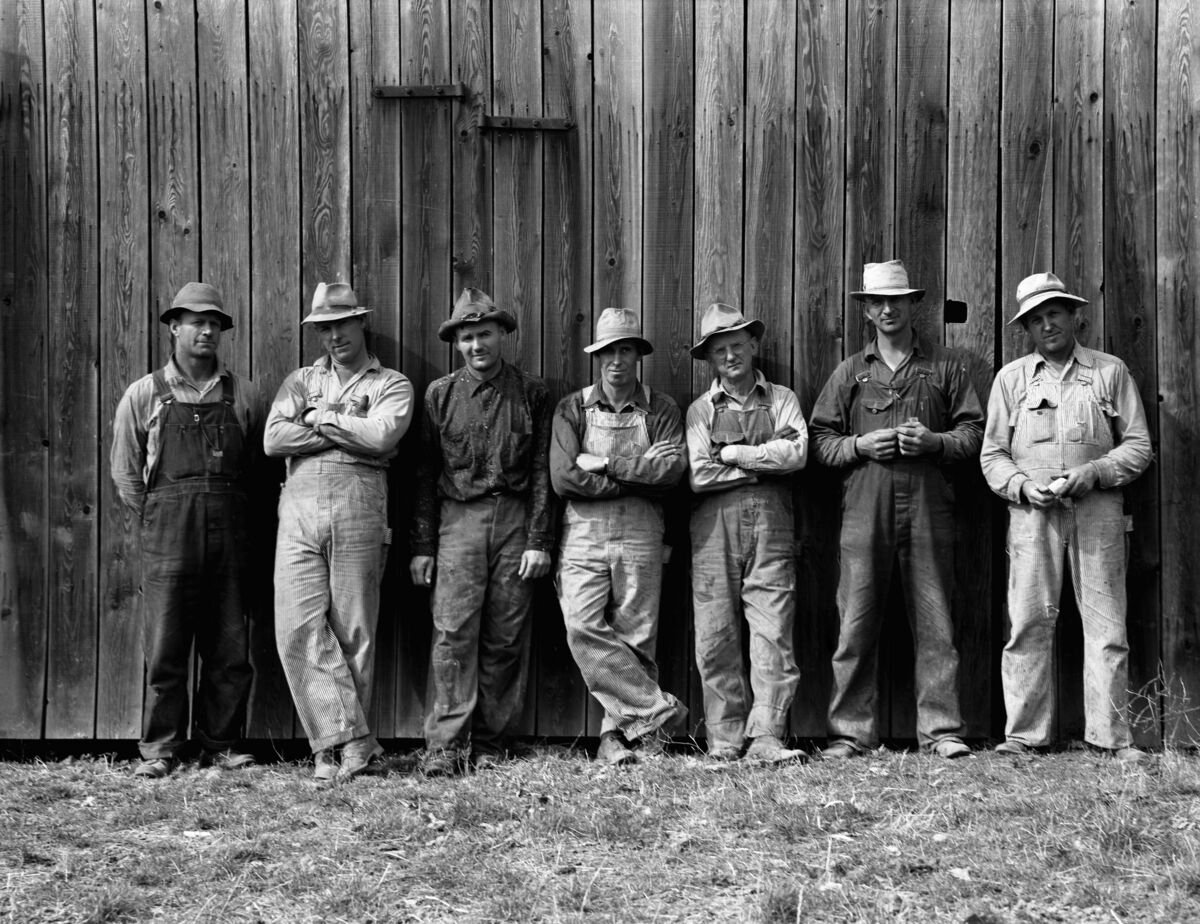 Dorothea Lange, Here are the farmers who have bought machinery cooperatively. Photographed just before they go to dinner on the Miller farm where they are working. West Carlton, Yamhill County, Oregon, 1939. Courtesy of the Library of Congress.