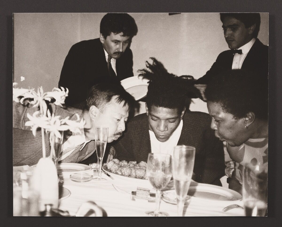 Andy Warhol, Michael Chow, Jean-Michel Basquiat, Basquiats mother and friends, 1984. © 2018 The Andy Warhol Foundation for the Visual Arts, Inc./Licensed by Artists Rights Society (ARS), New York. Courtesy of MR CHOW.