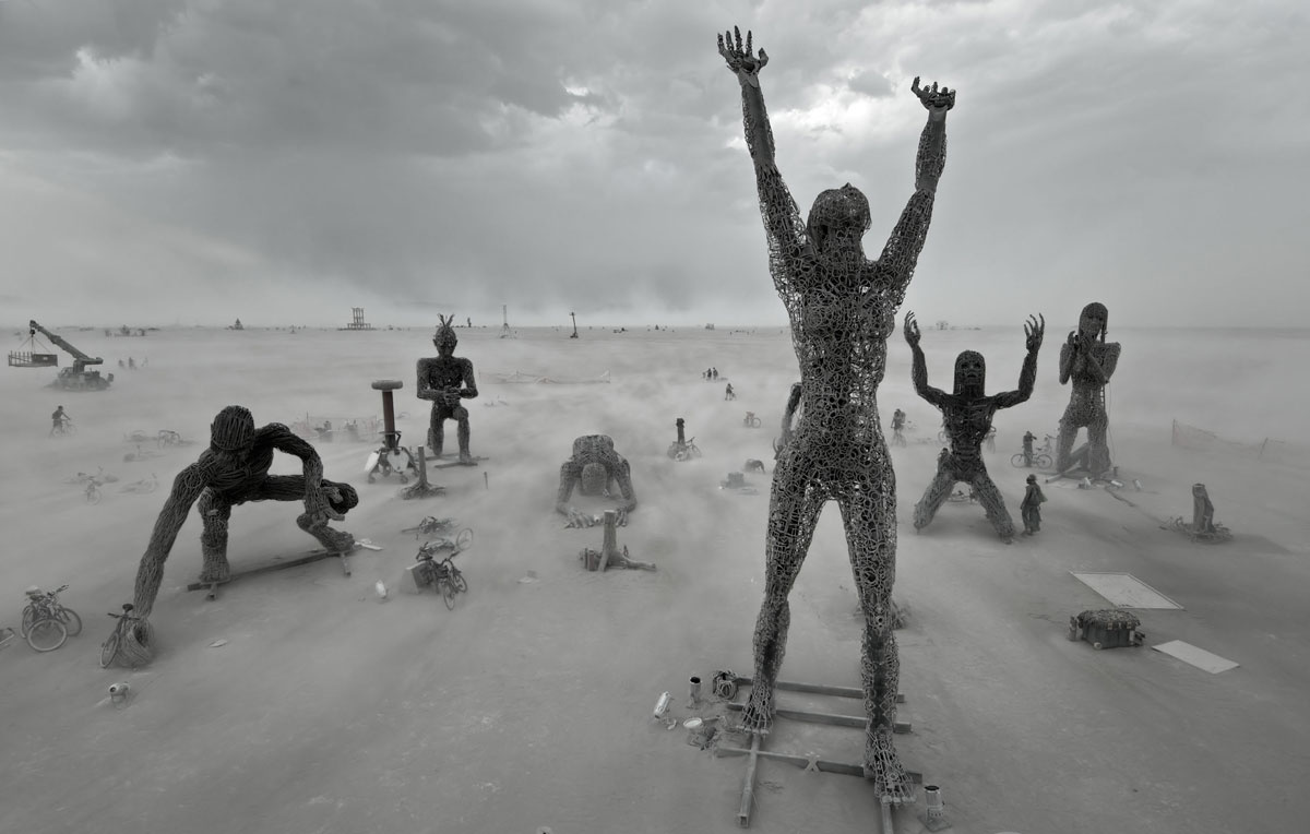 Why I Consider Burning Man The Greatest Cultural Movement Of Our Time - Minimalistic black white photo series captures energetic movements mid air