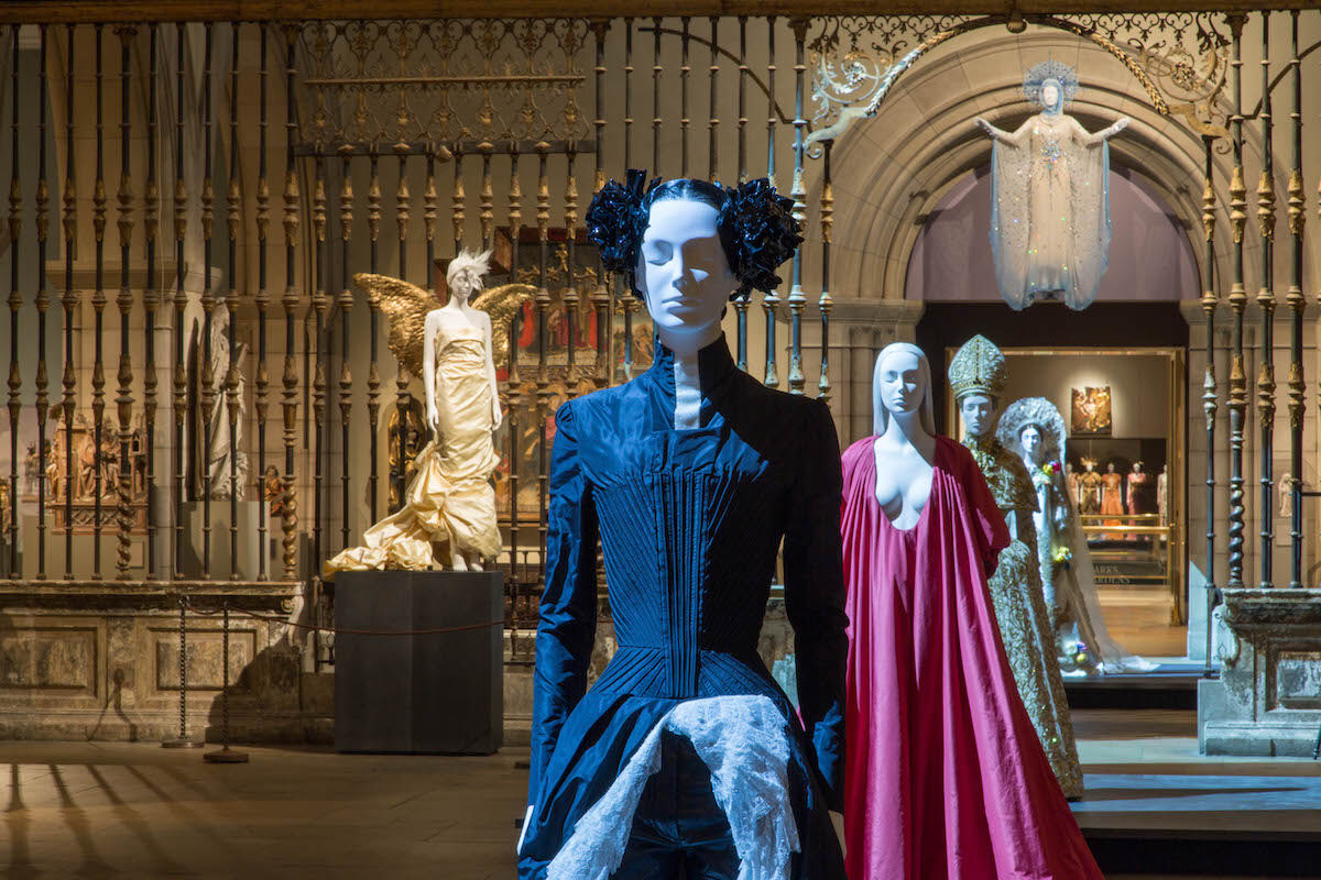 "Installation view of  ""Heavenly Bodies: Fashion and the Catholic Imagination."" Photo © The Metropolitan Museum of Art."