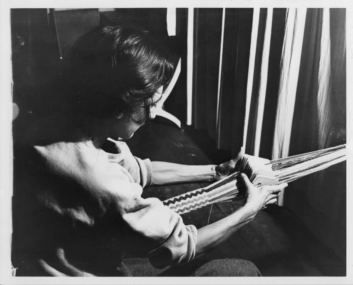 Anni Albers card weaving at Black Mountain College. © 2019 The Josef and Anni Albers Foundation / Artists Rights Society (ARS), New York. Courtesy of Western Regional Archives, State Archives of North Carolina, The Josef and Anni Albers Foundation, and David Zwirner.