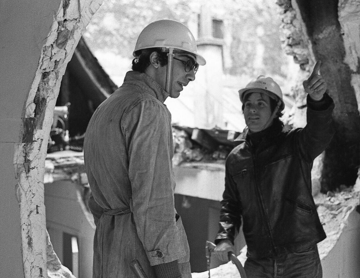 Gordon Matta-Clark and Gerry Hovagimyan, working on Conical Intersect, 1975. © Estate of Gordon Matta-Clark/Artists Rights Society (ARS), New York and David Zwirner, New York.