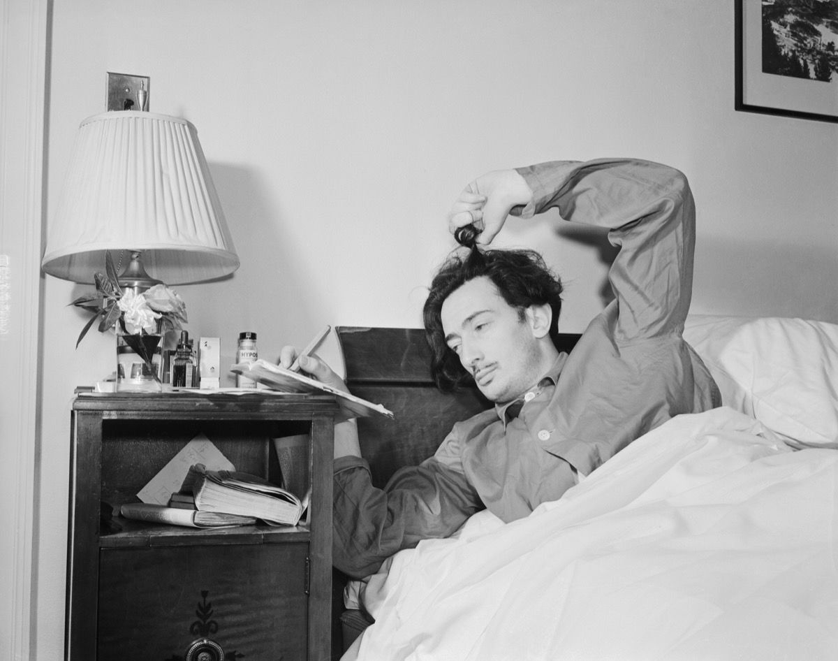 Salvador Dali, surrealist painter, in bed. Photo by Bettmann, via Getty Images.