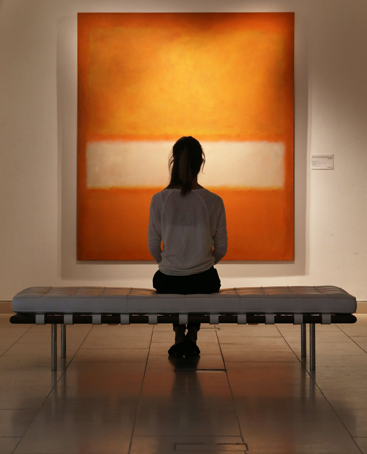 Christie's staff member looks at Mark Rothko's No 11 (Untitled), London, 2013. Photo by Peter Macdiarmid/Getty Images