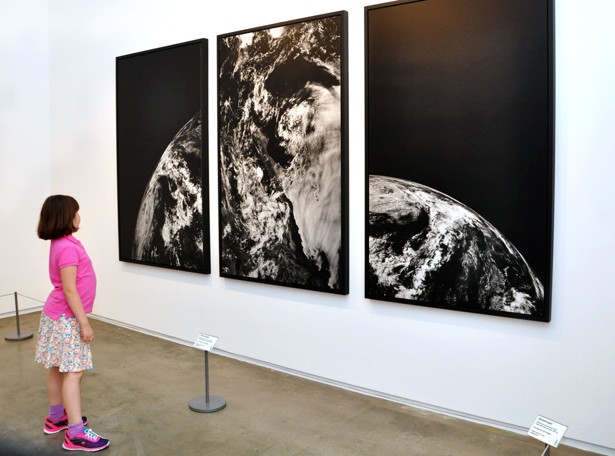 Marilyn Bruno observes Andrew Zuckerman's Earth Triptych (Earth 1, Earth 2, Earth 7), 2015. Photo by Veronica Bruno, High Value Images. Courtesy of Veronica Bruno.