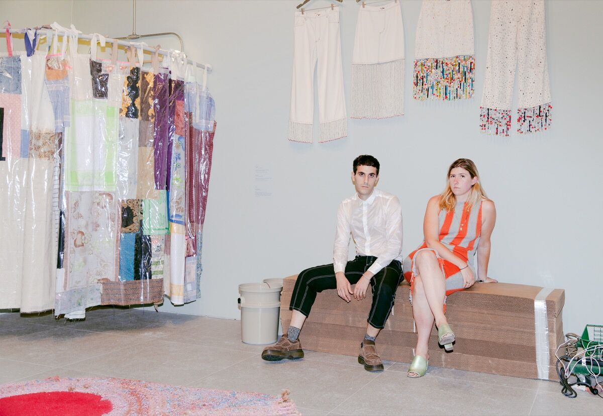 "Mike Eckhaus and Zoe Latta inside their exhibition, ""Eckhaus Latta: Possessed,"" at the Whitney Museum of Art, 2018. Photo by Thomas McCarty. Courtesy of the Whitney Museum of Art."