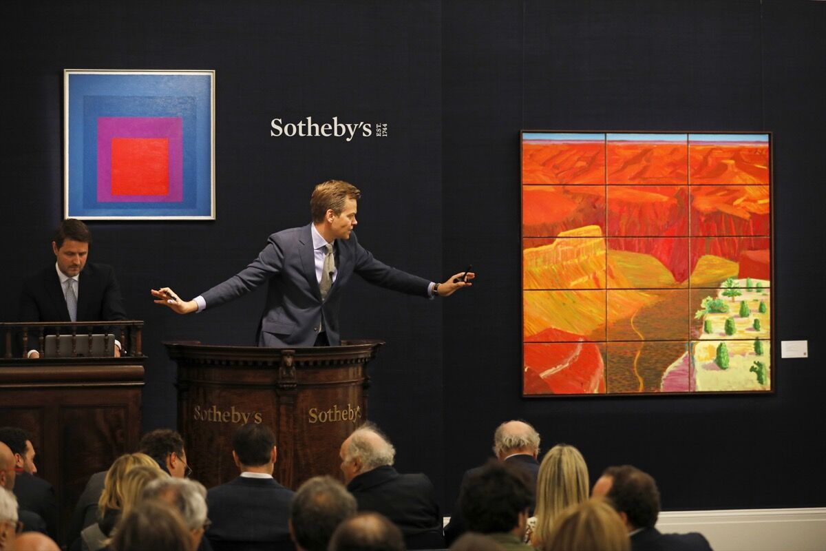 Oliver Barker fields bids at Sotheby's Contemporary & Italian Art evening sales. Courtesy of Sotheby's.