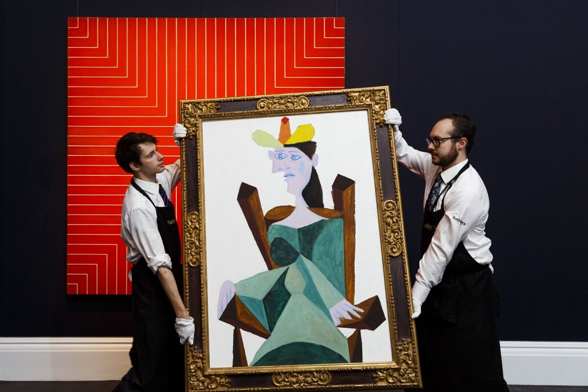 Frank Stella's Delaware Crossing and Picasso's Femme assise sur une chaise from the collection of A. Alfred Taubman are displayed as part of the Frieze week exhibition at Sotheby's on October 10, 2015 in London, England. Photo by Tristan Fewings/Getty Images for Sotheby's.