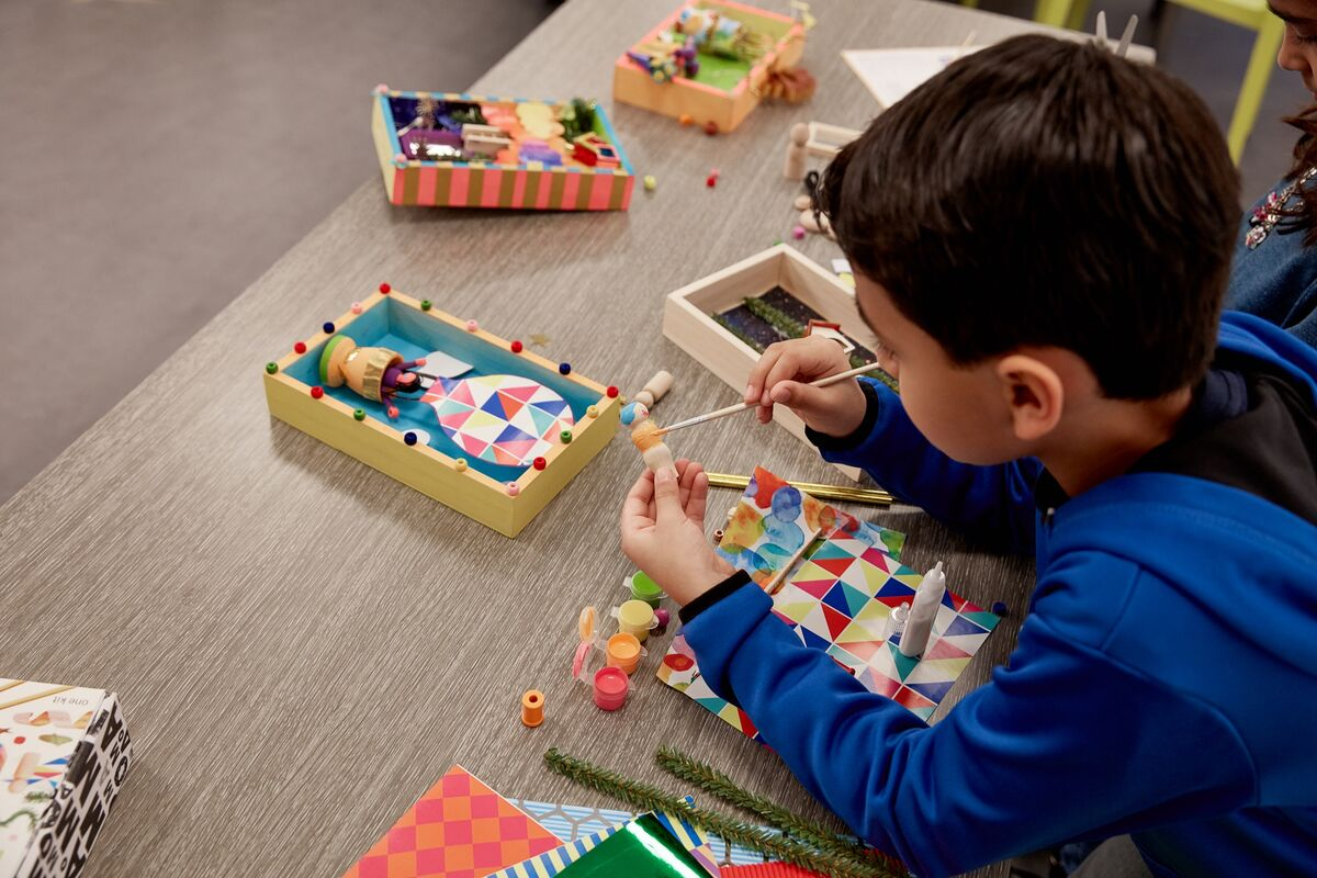 A kid making art with Making with MoMA's art kit. Image courtesy of MoMA.