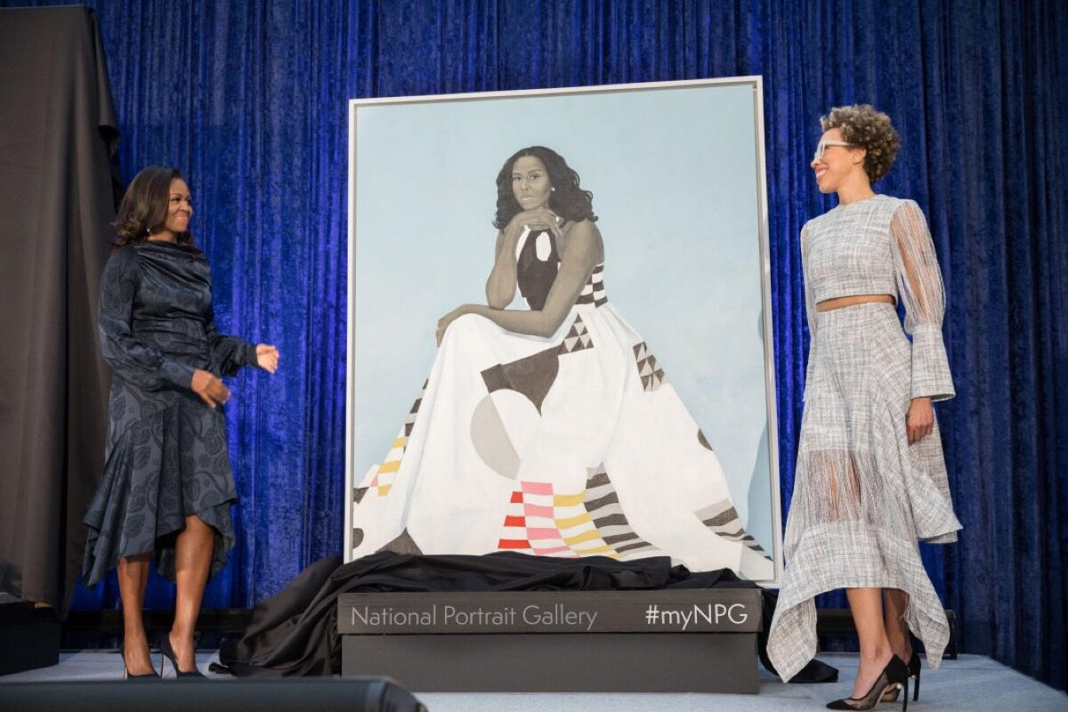 Michelle Obama and AmySherald stand alongside the newly unveiled portrait of the former first lady at the ceremony on February 12, 2018 . © Pete Souza. Courtesy of Princeton University Press.