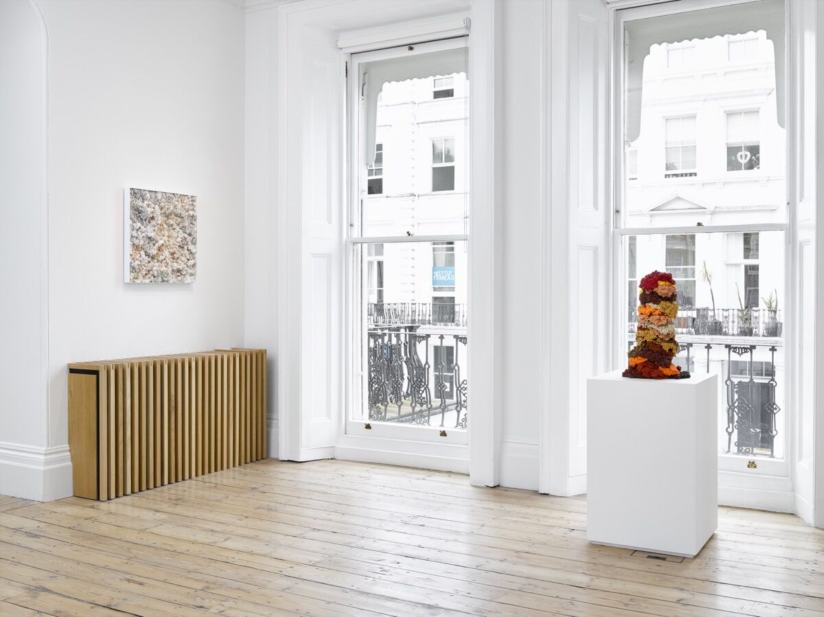 """Liza Lou, installation view, from left to right, of Terra Incognita, 2021; and Slow Jam, 2018, in """"Desire Lines"""" at Lehmann Maupin, London, 2021. Photo by Jack Hems. Courtesy of the artist and Lehmann Maupin."""