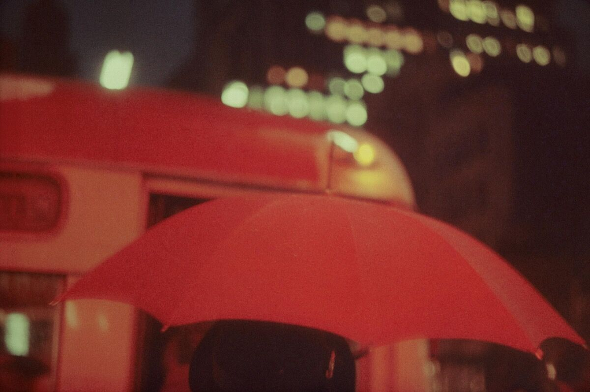 "Saul Leiter, Red Umbrella, 1951, from ""Early Color."" Courtesy of Steidl."