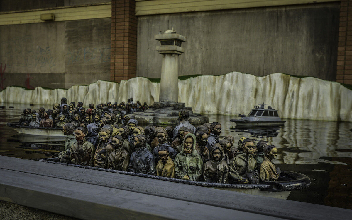 Remote-controlled refugee boats by Banksy at Dismaland. Photo by Sleeves Rolled Up, via Flickr.