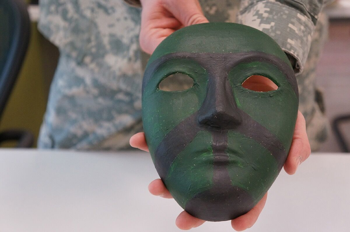 Sgt. Robert Fox painted this mask at the National Center of Excellence for the Intrepid's satellite office at Fort Belvoir, Virginia. Photo by Elizabeth M. Collins. Courtesy of the Department of Defense.