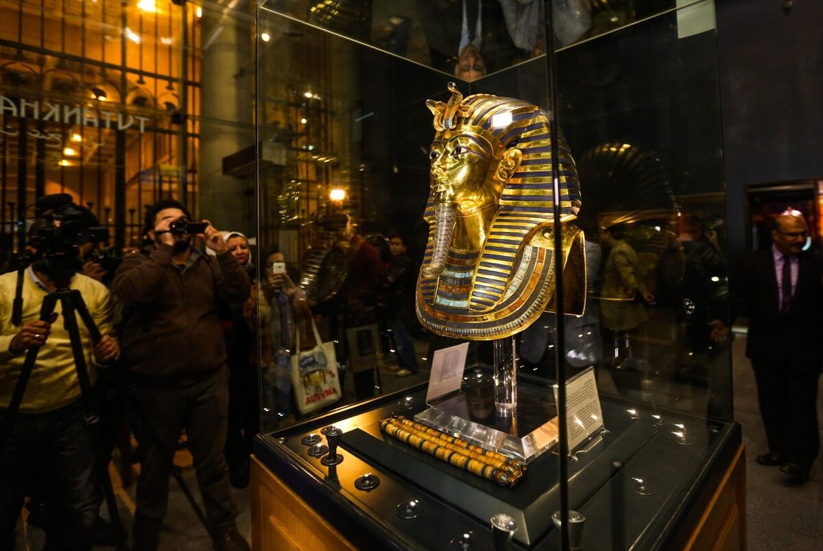 The golden funerary mask of King Tutankhamun on                    display during an unveiling ceremony at the Egyptian                    Museum, Cairo after its restoration process in 2015.                    Photo by Mostafa Elshemy/Anadolu Agency/Getty Images.