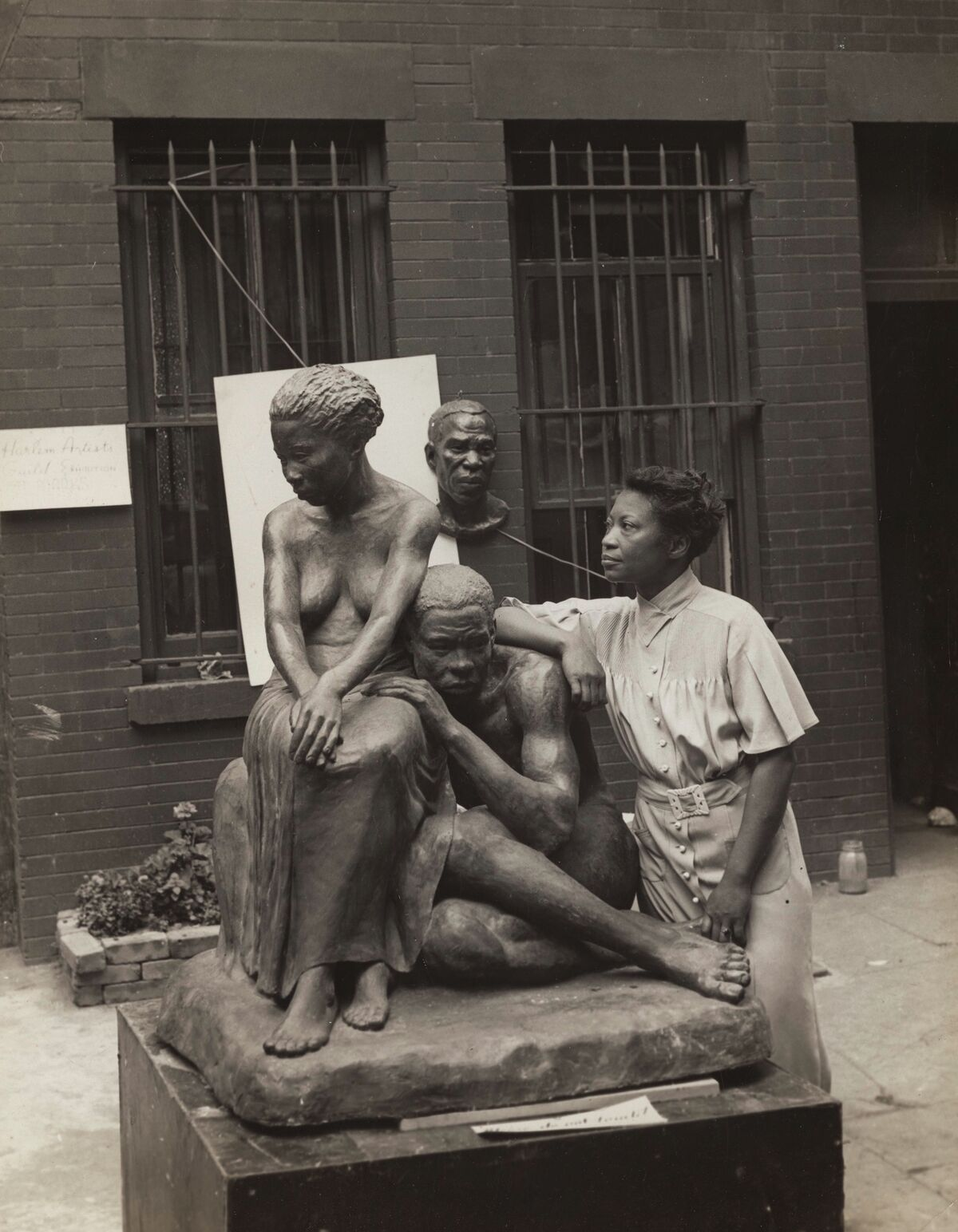 Augusta Savage with her sculpture Realization, 1938. Photo by Andrew Herman.