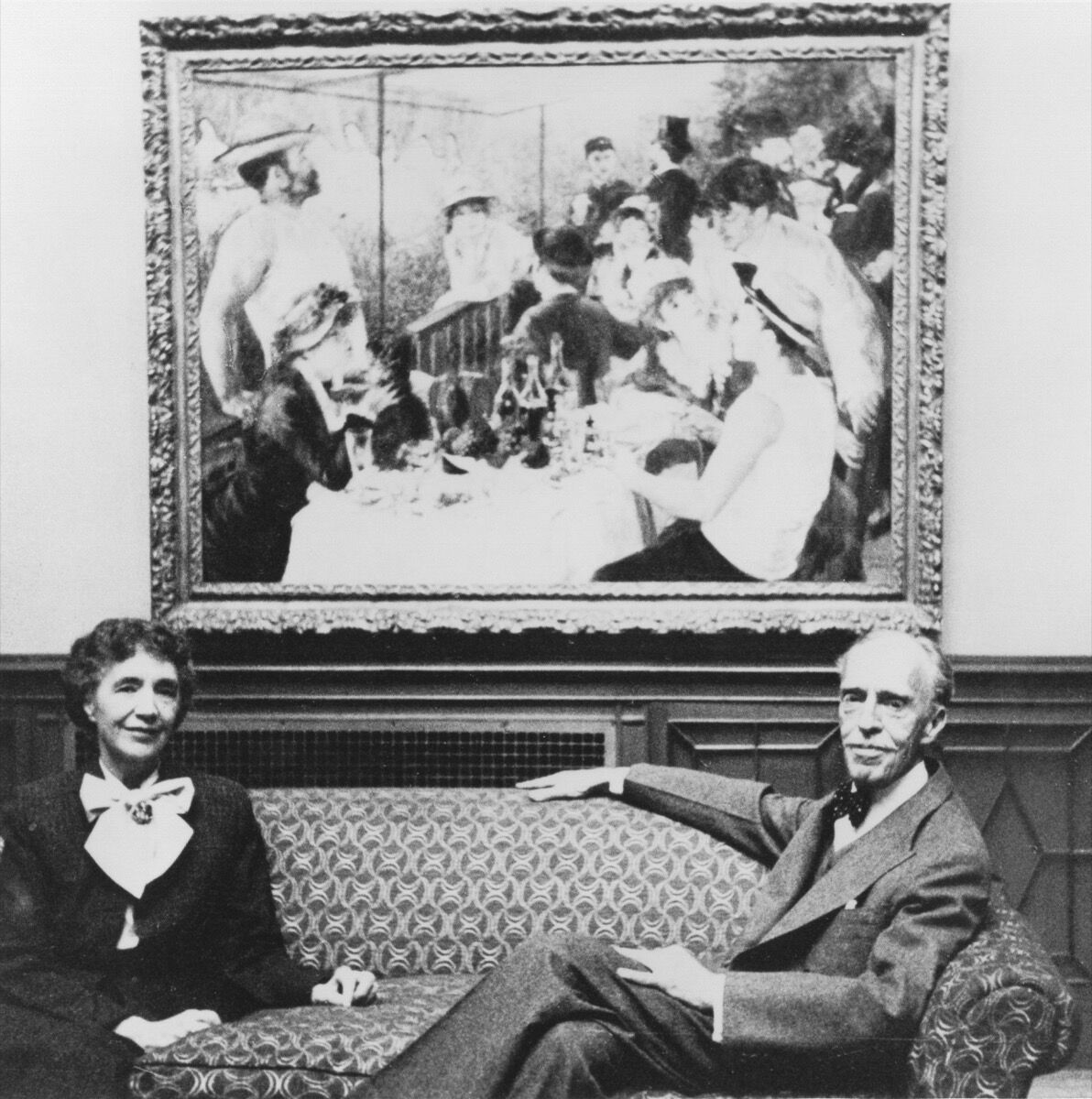 Marjorie and Duncan Phillips in front of Pierre-Auguste Renoir's Luncheon of the Boating Party , 1880–81, ca. 1954. Photo by Naomi Savage. Courtesy of the Phillips Collection, Washington D.C.