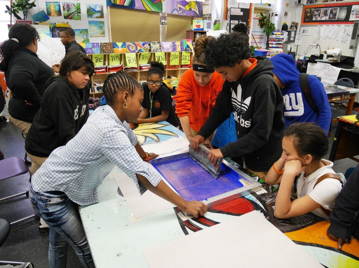 Students at MS22 experimenting with basic screen printing techniques. Courtesy of The Bronx Museum of the Arts.