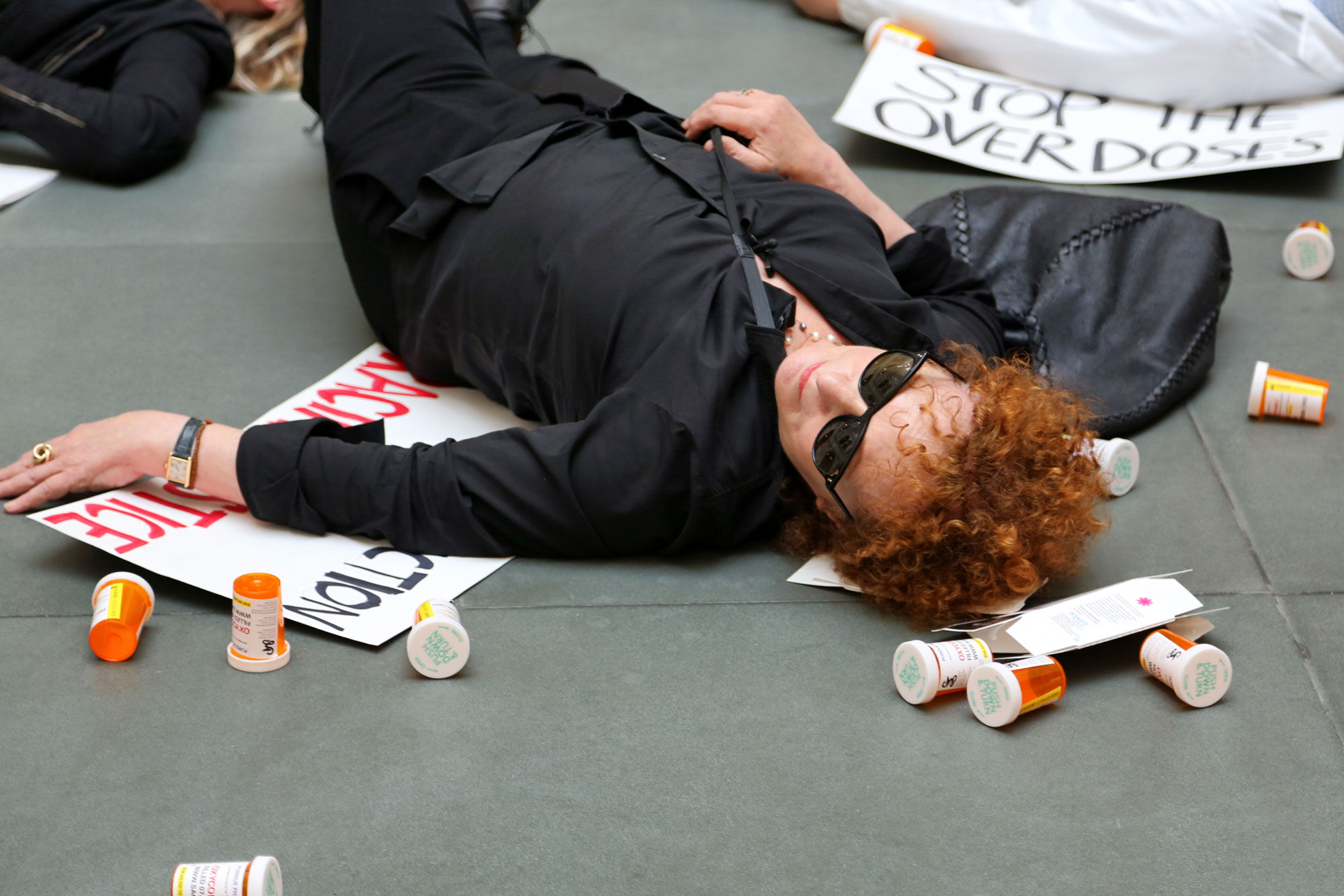 Photo of Nan Goldin during a protest at the Harvard Art Museums. Photo by TW Collins. Courtesy of P.A.I.N. Sackler.