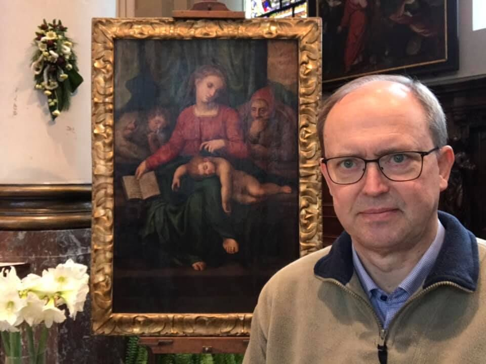 Pastor Jan Van Raemdonck with the painting. Photo by Jan Van Raemdonck, via Facebook.
