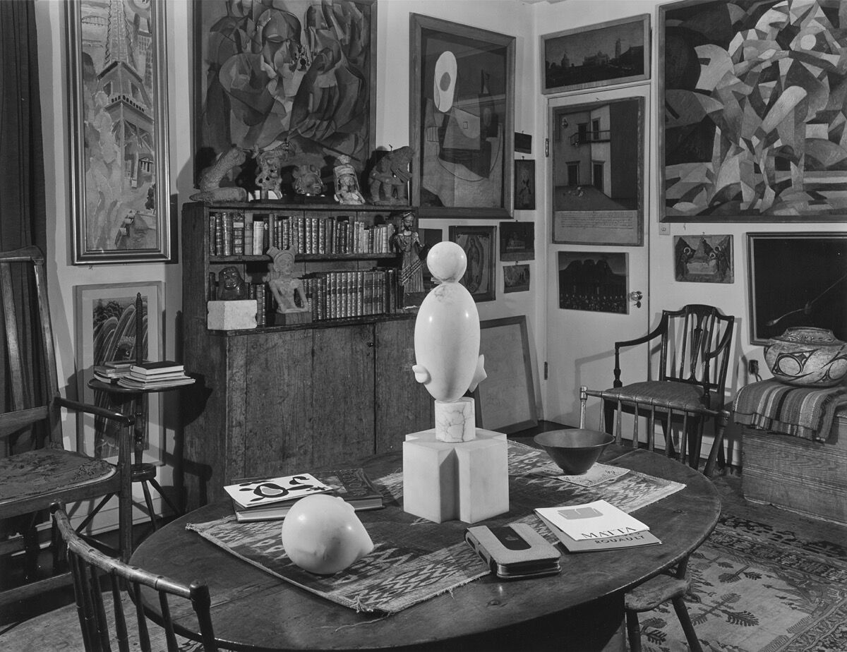 Sitting room, ca.January 1951. Photo by Floyd Faxon. Courtesy of Philadelphia Museum of Art, Library and Archives, Arensberg Archives. Pictured artworks: Constantin Brancusi, White Negress [I], 1923, and Prometheus, 1911. © Succession Brancusi – All rights reserved (ARS) 2020; Marcel Duchamp, Portrait of Chess Players, 1911. © Association Marcel Duchamp / ADAGP, Paris / Artists Rights Society (ARS), New York 2020; Francis Picabia, Dances at the Spring, 1912. © 2020 Artists Rights Society (ARS), New York / ADAGP, Paris; Pablo Picasso, Still Life: The Table, 1921. © 2020 Estate of Pablo Picasso / Artists Rights Society (ARS), New York.