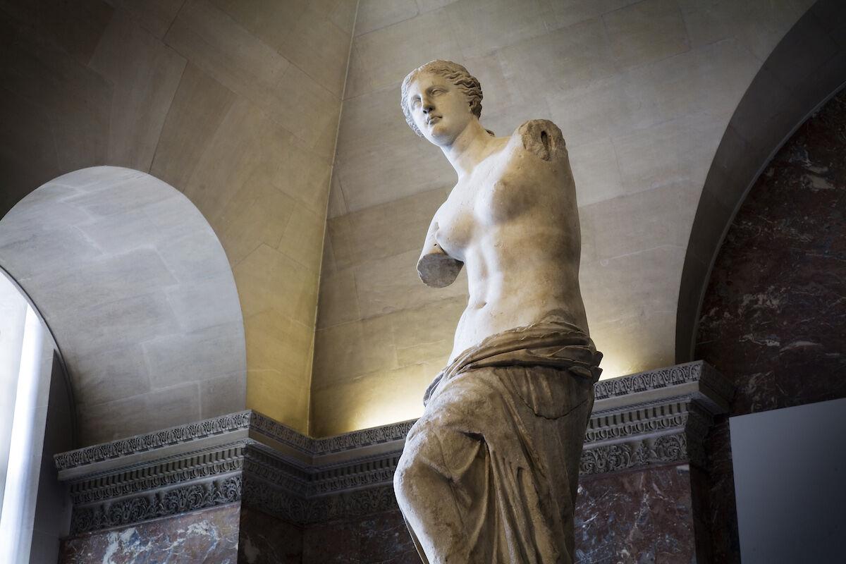 The Venus de Milo at the Louvre. Photo by Jorge Royan, via Wikimedia Commons.