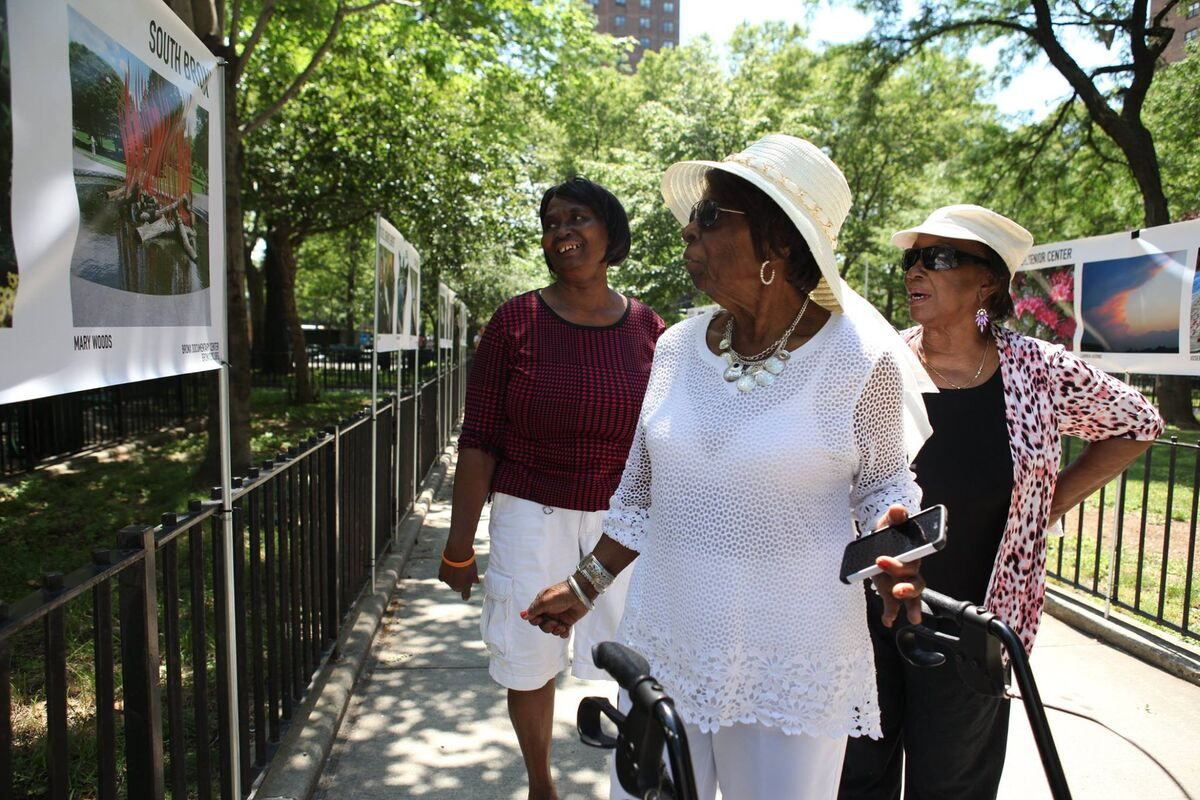 """Opening reception for the Mitchel Senior Center's exhibition """"Photographing My Life,"""" which showcases photographs taken by the Bronx Documentary Center's photo program for older adults, at the Mitchel Housing Project, 2017. Photo by Roy Baizan/Bronx Documentary Center. Courtesy of the Bronx Documentary Center."""