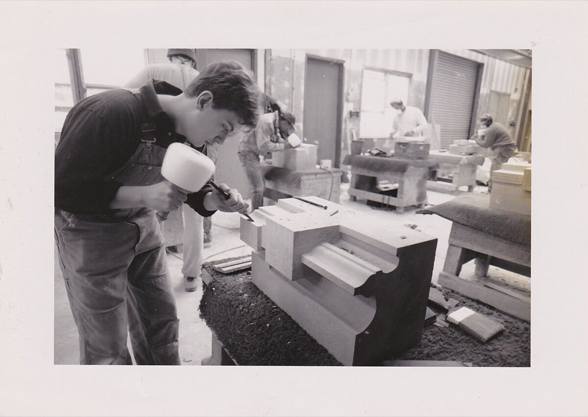 Chris Pellettieri working in the stone-carving studio. Courtesy of the artist.