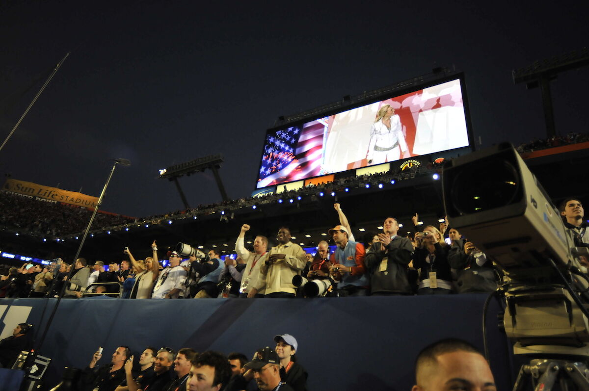 Carrie Underwood performs the U.S. National Anthem at Super Bowl XLIV, held in Miami in 2010. Photo by TSgt Shelley Gill, via Wikimedia Commons.
