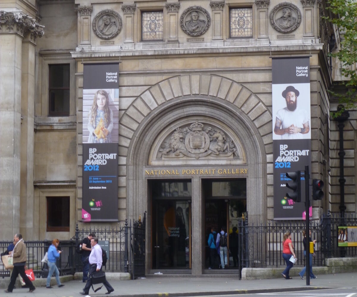 """Banners for the """"BP Portrait Award"""" on the exterior of the National Portrait Gallery in London. Photo by Grahamrob, via Wikimedia Commons."""